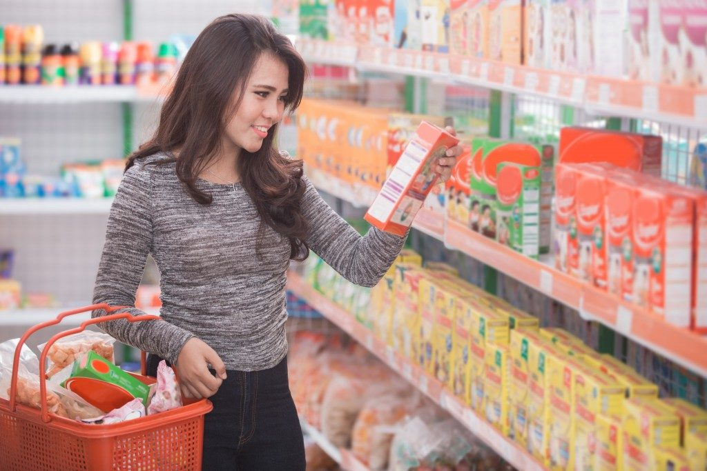 Girl buying stuff at the grocery