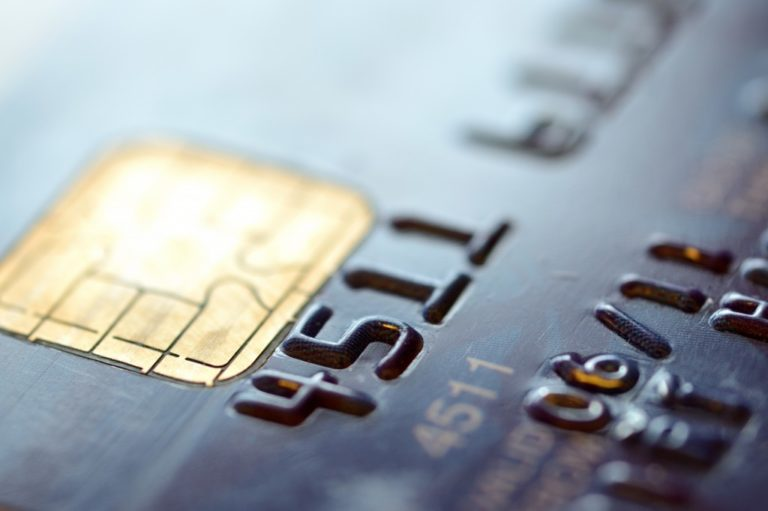 Low key macro shot with old credit card