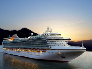 Luxury cruise ship sailing from port on sunrise