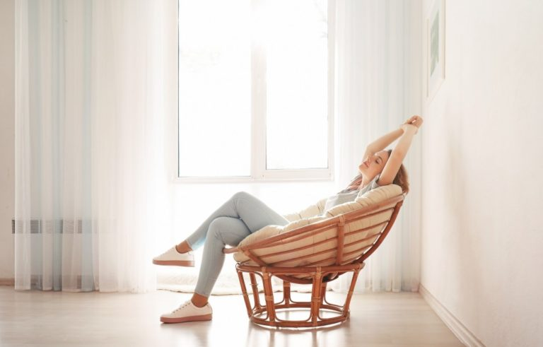 woman sitting on a comfy chair at home