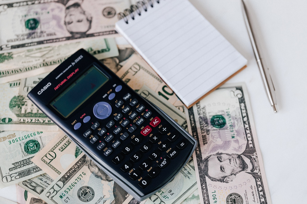 calculator with money and notebook