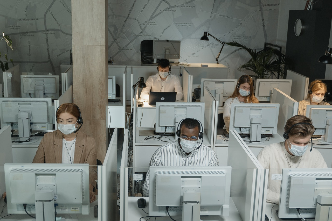 customer service agents wearing facemasks
