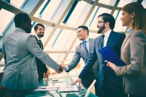 shaking hands businessmen