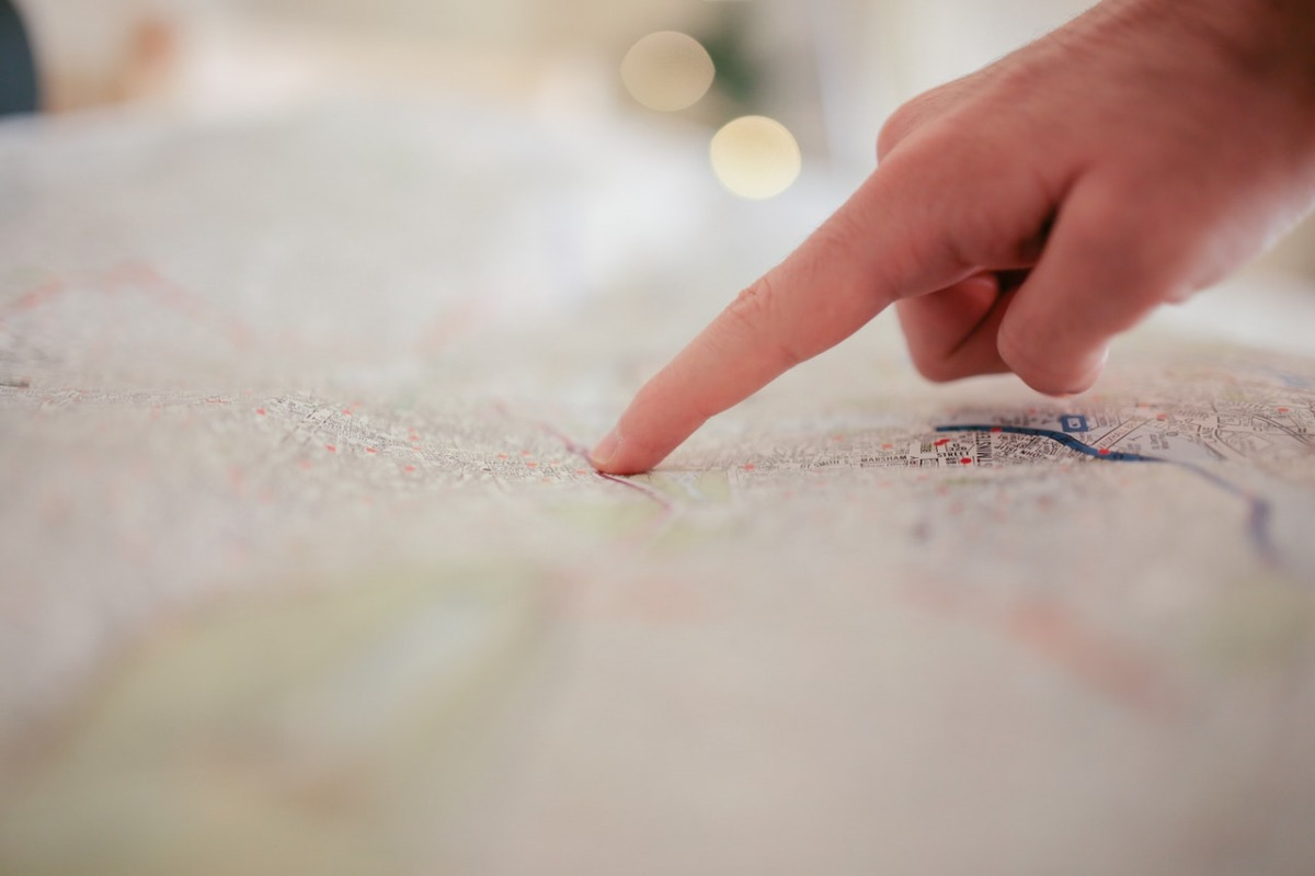 person pointing on a map