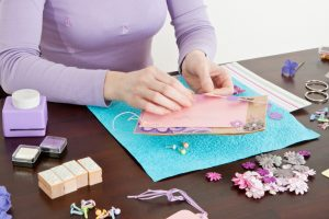 woman making handcrafted art